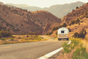 Airstream trailer driving down road