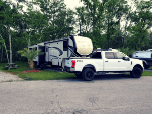 Truck and 5th wheel parked at Deland KOA